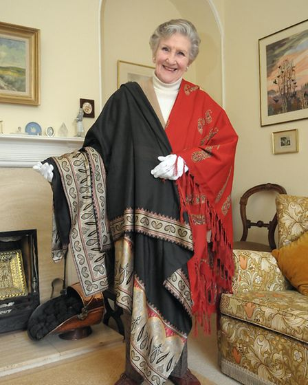 Helen Hoyte with some of the original Norwich shawls. Photo: Andy Darnell.
