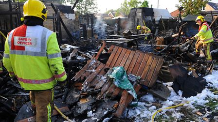 Firefighters at the Gurney Road property in Costessey where fire destroyed outbuildings of two neigh