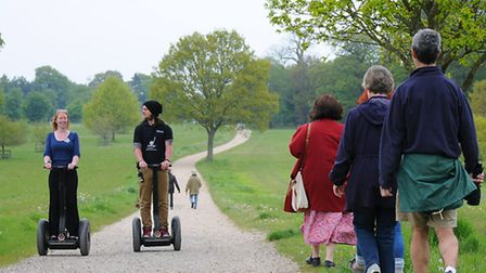 EDP reporter Lucy Clapham goes on a guided tour of Blickling Hall grounds on a Segway. Pictured with