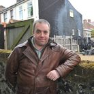 Owen Benton outside the properties affected by the fire he came across while returning home.PHOTO BY
