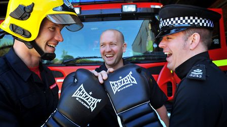 Ryon Martin tries to ensure fair play as firefighter Andy Nash and police sergeant Dave McCormack sq