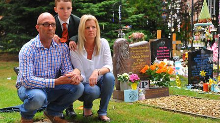 Kevin Price with partner Andrea Barrett and son Albert next to Maisie Price's grave where the bench