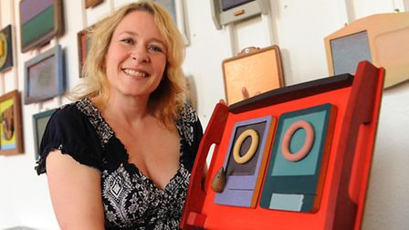 Claire Kidman with the celebratory memorial exhibition of her former partner, Adie Porter's painted