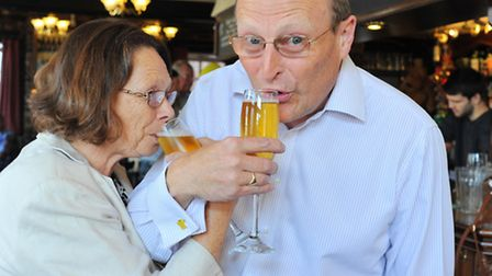 Chris and Glynis Higgins celebrate with champagne flutes of real ale at the Trafford Arms. Photo: Bi