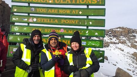 Sunil Sharma holding the NCFC canary with Jane Foley and another colleague who took part in the trek