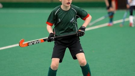 James Cross, member of Norwich Dragons Hockey Club, shows off the teams' new kit