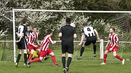 Action from Swaffham Town's 1-0 home defeat to promotion rivals Halstead Town at Shoemakers Lane. Pi