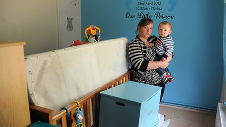 Jemma Waterfield, and her 11-month-old son Harley in Harley's bedroom where Jemma has put the furnit