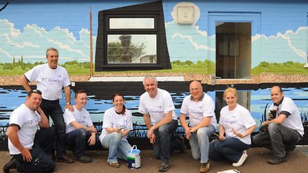 BT Openreach customer service engineers volunteer to paint a mural at the Phoenix Centre. From left,