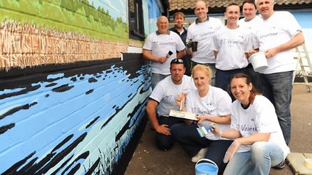 BT Openreach customer service engineers volunteer to paint a mural at the Phoenix Centre. Picture: D
