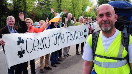 Members of the Irish Society of East Anglia welcome round Britain's counties walker Colm Farrell to