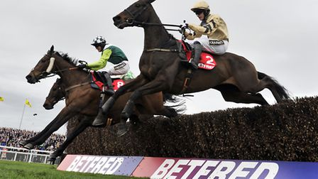 Boston Bob (nearside) and Paul Townend win the Betfred Melling Chase during Ladies Day of the Crabb