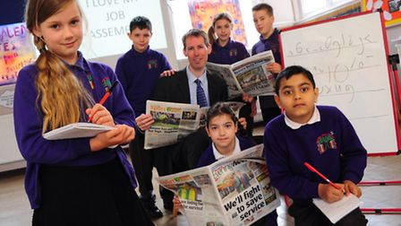 Reporter Martin George explains the role of a journalist to pupils at Magdalen Gates Primary School,