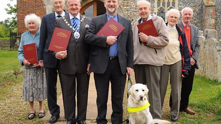 The leather bound Sprowston Memorial books, collated by the Sprowston Heritage group, are presented