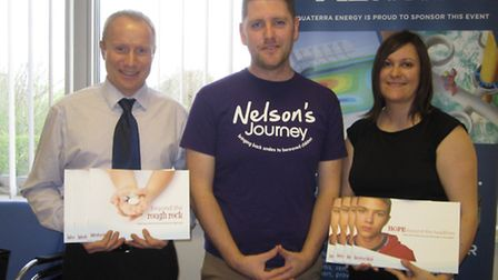 Nelson's Journey support worker Ryan Doubleday (middle) receives books from John Rainbow and Lisa Hy