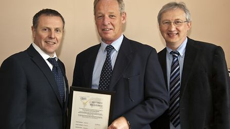 Bruce Lambert (centre) presents the ISO 14001 certificate to Graham Newman (left) and Keith Dixon. P