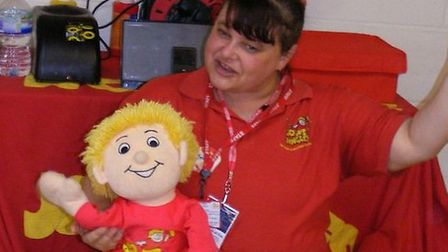 Beckie Clifton of Jo Jingles with a puppet to entertain the children at Taverham Hall Nursery. Pictu