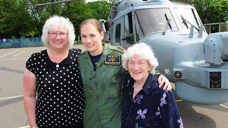PO Kara Hillyard, who grew up in Bungay, arrives in a Royal Navy helicopter at Stoke Holy Cross Prim