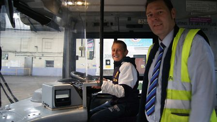 Sam Jones, 11, and Danny Beales, Operations Manager at First's Great Yarmouth depot, on a double dec