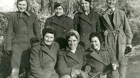 Land-girls pose at Browick Farm on Christmas Day 1944. The cows still had to be fed and milked !