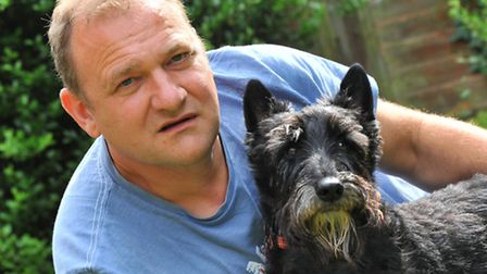 Mark Marshall and his dog Hector who were attacked by another dog while out walking.Photo by Simon F