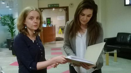 Rachel Ward, of the Save Cavell campaign, handing a petition to a member of staff at the Department