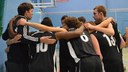 The City College Norwich basketball team in a huddle during one of their matches. Photo: Kara Websda