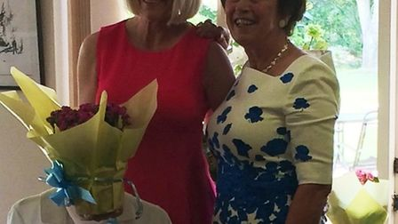 Julie Proctor (left) is presented with her prizes by ladies president Brenda Neill following the Lad