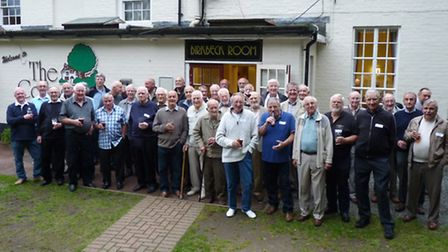 Cheers! LSE pensioners line up for Bernard Rose's camera.