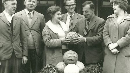 Legendary Town Clerk Tom Turner, then Football Club Chairman, accepts from Bella Parsons agift of fo