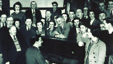 With the multi-talented Town FC captain Ken Percival on the piano, players and supporters enjoy a so
