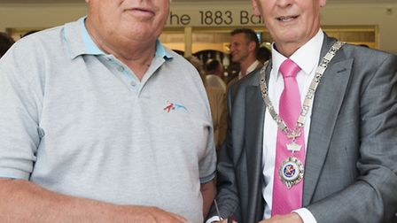 Mayor of Wymondham, Colin Foulger, right, cuts the ribbon to officially re-launch Wymondham Town FC