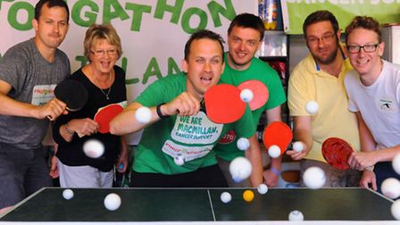 Rob Goodson, 3rd left, with his family and friends, during his pingpongathon, 24 hour table tennis m