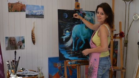 Artist Susan Clyne is putting on a new exhibition on in The Forum; Painting in her studio. Photo cre