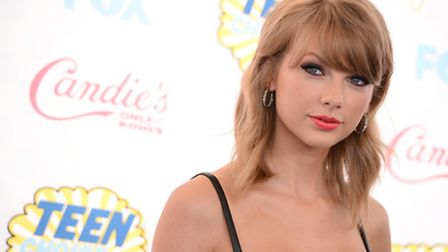 Taylor Swift arrives at the Teen Choice Awards at the Shrine Auditorium on Sunday, Aug. 10, 2014, in