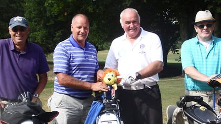 The men's captain's team at Swaffham Golf Club's recent Yellow Ball team competition in aid of Bridg