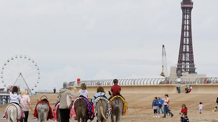 EMBARGOED TO 0501 TUESDAY JULY 15File photo dated 25/5/2009 of donkeys on Blackpool beach. Global tr