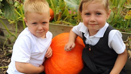 Edith Cavell Academy children at the school's allotment after their harvest festival service. Caden-