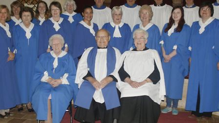 Rita Berchem and Duncan Pigg (seated front right and second right) with choir members at the end of