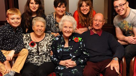 Mary Biggs celebrates her 101st birthday with the other four generations of her family. From left, b