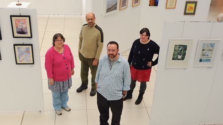 Members of the Well Artists, artists who have experienced mental distress, with their exhibition at