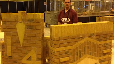Seb showing off his bricklaying skills at the competition