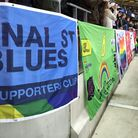 Proud Canaries displaying their banner at Wembley