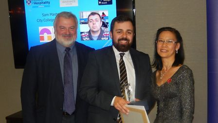 Sam receiving his award from the Institute of Hospitality