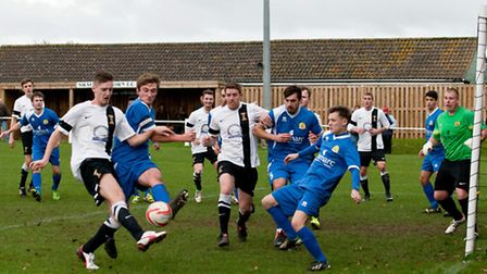 Action from Swaffham Town's 2-1 home win against March Town United, Matthew Castellan tries to get a