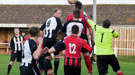 Hat-trick hero Jamie Buhlemann goes up for a header in an 8-1 win for Swaffham Town Reserves against