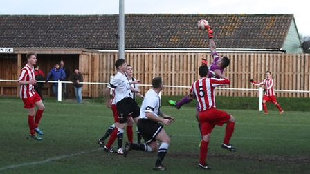 Swaffham goalkeeper Lee Brooks commanding his area during the Pedlars' 1-1 draw with Halstead Town a