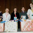 Staff and students from Easton College present their donations to Hannah Worsley from Norwich Foodba