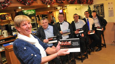 Spixworth 2015 Calender Lads! Charity calendar organiser Suzanne Hastings with (l to r) Ian Doy, Mat