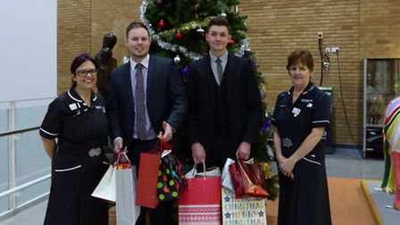Inchcape staff with their donations to the Norfolk and Norwich University Hospital